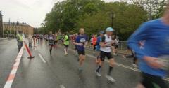 People running in the rain Stock Footage