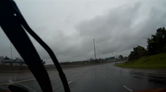 POV dashcam driving in the rain on the highway Stock Footage