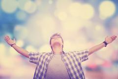 Man enjoy freedom with blur background Stock Photos
