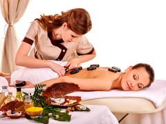 Woman getting spa lastone therapy outdoor Stock Photos
