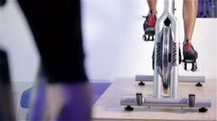 Spinning class: exercise bike pedalling Stock Footage