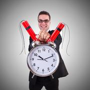 Man with time bomb isolated on white Kuvituskuvat