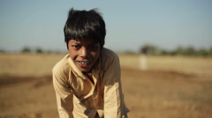 Indian village boy smiling, close up, shallow DOF - stock footage