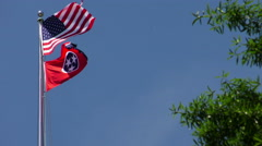 The U.S. Flag and the Tennessee State Flag Waving in the Wind Stock Footage