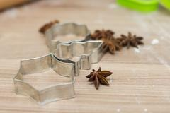Cookies cutter on the wooden table. - stock photo