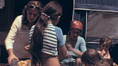 USA 1966: hippy community eating and camping outdoor - stock footage