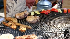 Street Food Festival - roast meat burgers and grilled vegetables Stock Footage