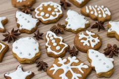 Christmas Gingerbread Cookies homemade different forms on wooden table. Stock Photos