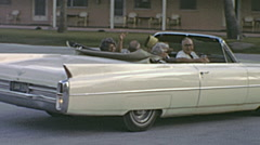 USA 1966: seniors driving a cadillac Stock Footage