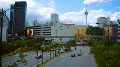 KUALA LUMPUR, MALAYSIA - CIRCA FEB 2015: Typical urban traffic in downtown Ku Stock Footage