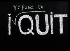 I refuse to quit message, handwriting with chalk on blackboard - stock photo