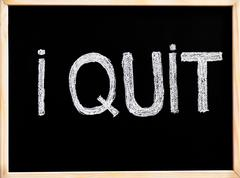 I Quit, handwriting with chalk on wooden frame blackboard, lifestyle c Stock Photos