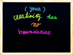 Your creativity has no boundaries message, handwriting with chalk on blackboard - stock photo