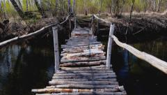 Wooden bridge over the river Stock Footage