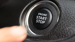 Engine start stop button from a modern car interior - stock footage