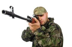 Stock Photo of Solider holding gun isolated on white