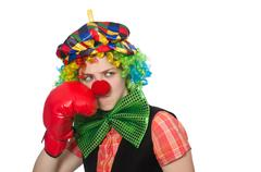Female clown with box gloves  isolated on white - stock photo