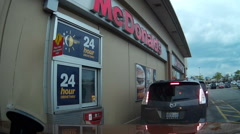 POV dashcam going through fast food drive through Stock Footage
