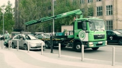 ASTRAKHAN, RUSSIA - MAY 17, 2015 Car evacuation by tow truck of Moscow parking Stock Footage