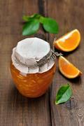 Orange jam in glass jar Stock Photos
