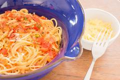 Italian pasta with ham, tomato and champignon mushrooms Stock Photos