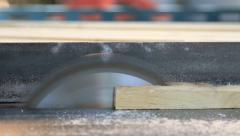 Close up carpenter cutting plank wood by circular saw. Stock Footage