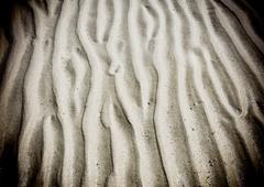 Wave line pattern in beach sand - stock photo
