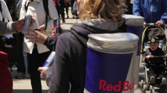 Redbull Girls giving out free promotional drinks at an event Stock Footage