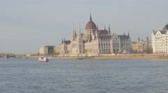 Beautiful Hungarian parliament buiding on banks of Danube river 4K 2160p Ultr Stock Footage