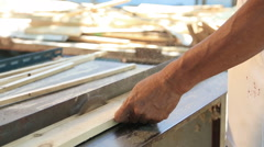 Close up carpenter cutting plank wood by circular saw. - stock footage