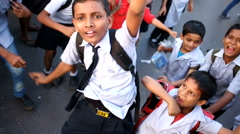 Group of school children running around and smiling at street. Stock Footage