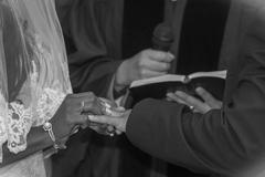 Exchanging rings at the alter - stock photo