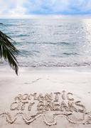 Romantic City Breaks message written on sand, vacation concept - stock photo