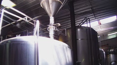 Low Angle Beer Brewing Tanks At Brewery - stock footage