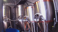 Row Of Beer Brewing Tanks At Brewery Stock Footage