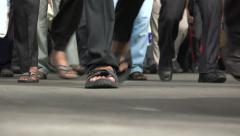 Low angle video of train passengers exiting platform in Mumbai, India Stock Footage