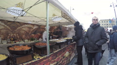 Cook vendors sell freshly prepared hot food in outdoor festival Stock Footage
