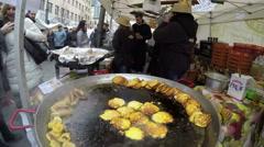 Potato pancakes baked in large pan outdoor kitchen. 4K Stock Footage