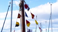 Various flags on a sailing boat blowing in the wind Stock Footage
