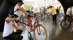 Staff washes bike using pressure washers. Stock Footage