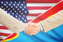 Businessmen shaking hands - United States and Congo-Kinshasa - stock illustration