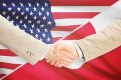 Stock Illustration of Businessmen shaking hands - United States and Greenland