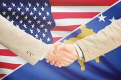 Stock Illustration of Businessmen shaking hands - United States and Kosovo