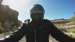 Motorcyclist On Narrow Canyon Road With Train In Background Stock Footage