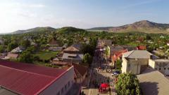 Flying over a small village in celebration day Stock Footage