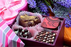 Chocolate sweets in gift boxes, lavender Stock Photos