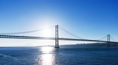 Sunset on the 25 de Abril Bridge in Lisbon Stock Footage