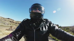 Speeding Motorcycle Rider On Bumpy Desert Road Stock Footage