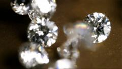 Diamonds Dropping Slow Motion Golden Surface - stock footage
