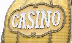 Antique Casino Sign with Lights on Building. Stock Photos